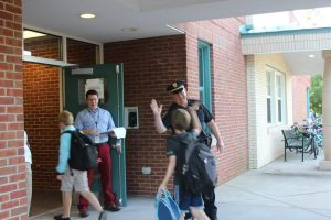 Sergeant John Burlett welcomes children back to Edgeworth Elementary on the first day of school